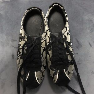 Trendy black and white Coach shoes